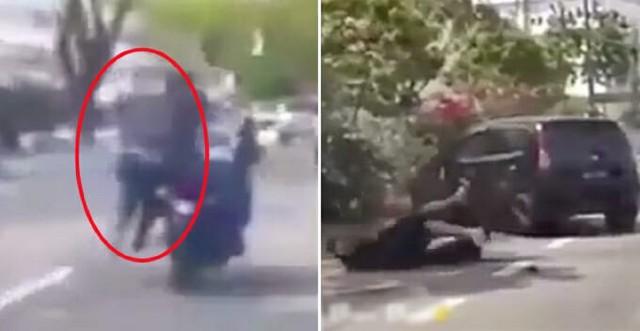 اقدام شجاعانه مالباخته در تعقیب سارق موتورسوار!در ملاکا مالزی